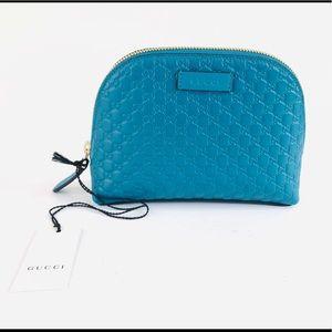GUCCI Microguccissima GG Cosmetic Case Mini Bag